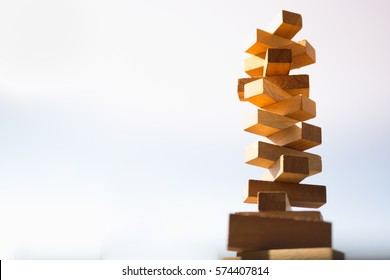 The tower stack from wooden blocks toy with sky background. Learning and development concept.