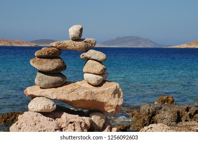 A tower of stones on Ftenagia beach at Emborio on the Greek island of Halki.