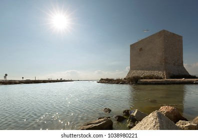 Tower of Tamarit backlit in Santa Pola, province of Alicante, Spain.