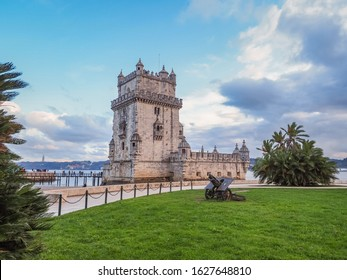 Belém Tower or Torre de Belém. Ancient, historic fortified quarter of Portuguese Manueline style on the northern bank of the Tagus river in Lisbon. Evening in capital of Portugal. Beautiful landscape.