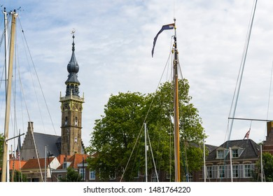 Tower of town hall, houses and boat masts. Veere, The Netherlands