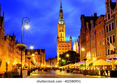 The tower of Town Hall and main pedestrian street on the old city center of Gdansk, Poland, in the late evening