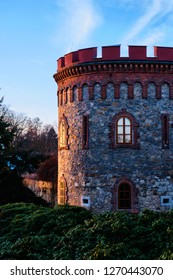 Tower in trebon at sunset by garden in winter