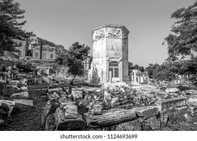 Tower of Winds or Aerides on Roman Agora, Athens, Greece. It is one of the main landmarks of Athens. Scenery of Ancient Greek ruins in Athens centre at Plaka district. Old Athens in black and white.
