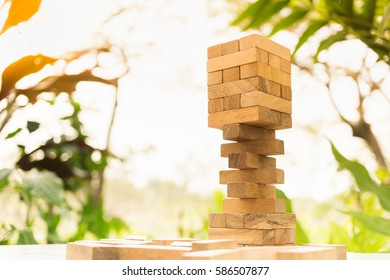 The tower from wooden blocks with nature background.