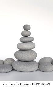 tower of zen stones on white background