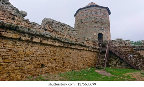 the towering Ackermansky fortress in a rainy, cloudy day