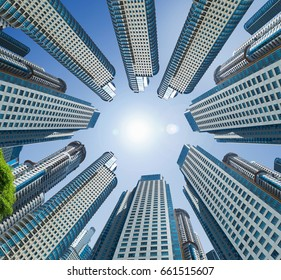 Towering buildings forming circle against the background of sky