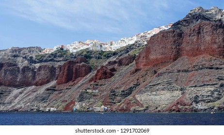 The towering pumice cliffs of Santorini, with their colourful layered striations.  The cliffs are on the edge of the caldera - a volcanic crater, now full of water