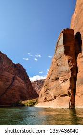 Towering Red Rock Formation On The Colorado River In Glen Canyon Arizona Under Beautiful Blue Sky