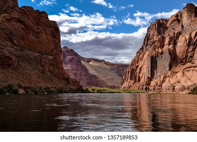 Towering Red Rock Sandstone Formation On The Colorado River in Glen Canyon