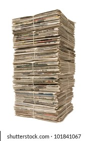 Towering stack of bound newspapers for recycling