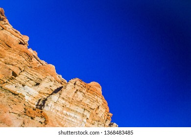 Towering walls of a cliff face in Red Rock Canyon State park in southern California.