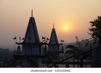 a towers of hindu ashram on a background of sunset sky