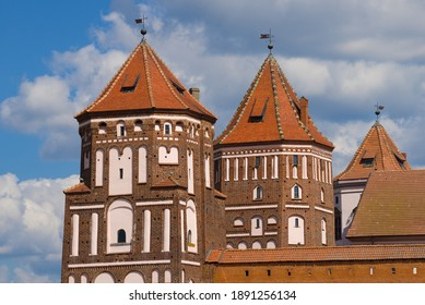Towers of the Mir Castle close-up on a sunny day. Mir, Belarus - Shutterstock ID 1891256134
