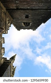 Towers and Turrets. A view looking upwards to the sky framed by towers and turrets
