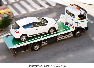 towing  truck car wrecker working  in city street