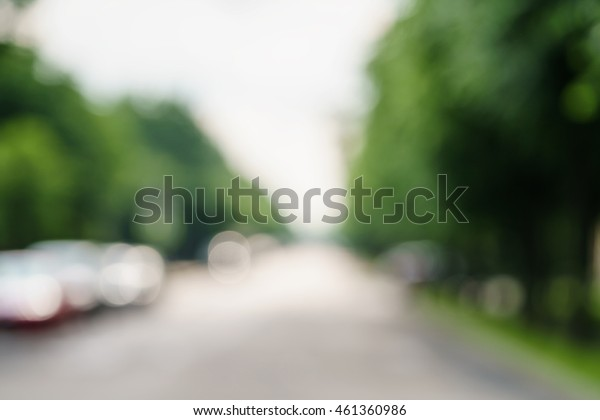 town alley with green trees background