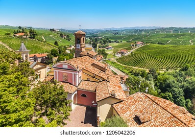 The town of Barolo among rolling hills with vineyards in Piedmont, Italy.
