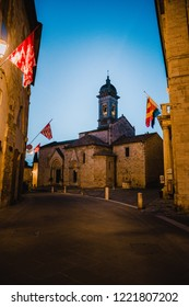 Town bell in the alleys of the Italian towns during the night with medieval flags