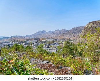 The town of Blaenau Ffestiniog lies ringed with slate quarries and mountains on a bright April spring day.