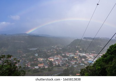 The town of Boquete in western Panama against characteristic light rain and rainbow. Boquete is known for the production of quality coffee.