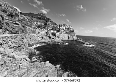 Town built on seaside rocks Cinque Terre, Italy, black and white image