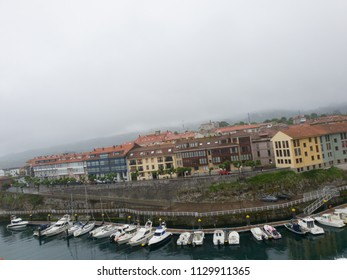 town by the sea with sky with fog