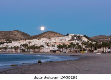 The town of Carboneras de Almeria under the moon, Spain