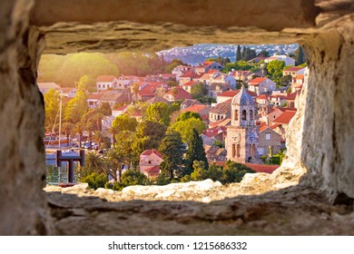 Town of Cavtat towers and waterfront view througf stone window, south Dalmatia, Croatia