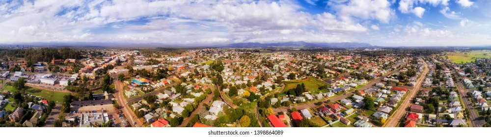 Town centre of Cessnock remote regional settlement in Hunter Valley of Australia. Wide aerial panorama over popular wine making region above streets, roads, houses and businesses.