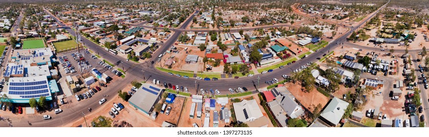 TOwn centre and shopping village with main street of Lightning Ridge town in outback Australia - centre of opal mining industry from above in wide aerial panoramic shot.