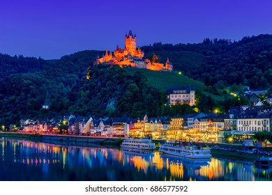 The town of Cochem, Germany, at night. It lies in the most romantic part of the Moselle Valley, where the river curves between two hiking paradises - Eifel and Hunsrueck.
