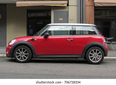 TOWN, COUNTRY - CIRCA AUGUST 2017: red Mini Cooper car (2013 model) with white roof