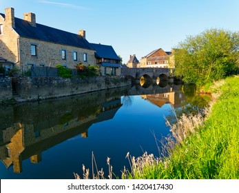 In the town of Ducey-les-Cheris insects fly above the still water of the River Selune.
