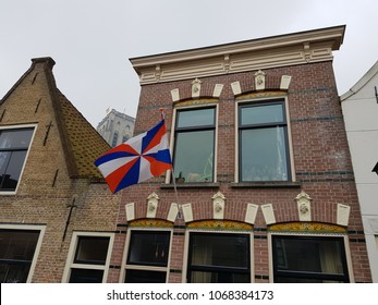 Town flag used on April Fools Day in historic town of Brielle, the st Catharina church in the background April 1 2018