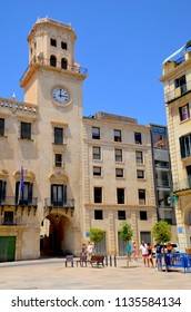 Town hall or city hall in Alicante, Baroque style clock tower with tourists in square. Alicante. Costa Brava, Spain. Europe. July 2018