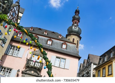 The town hall of Cochem in the Moselle Valley, Germany with some Easter egg decoration in the foreground.