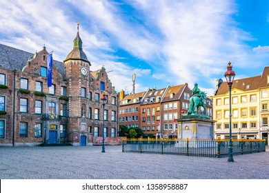 Town hall in Dusseldorf and statue of an Wellem, Germany