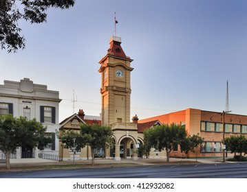 Town hall facade facing street with tall clock tower at sunrise in a small regional town Mildura, of Australia.