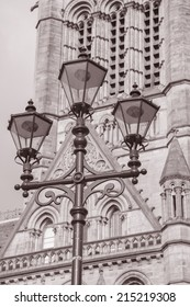 Town Hall, Manchester by Waterhouse (1877), England, UK with Lamppost in Black and White Sepia Tone