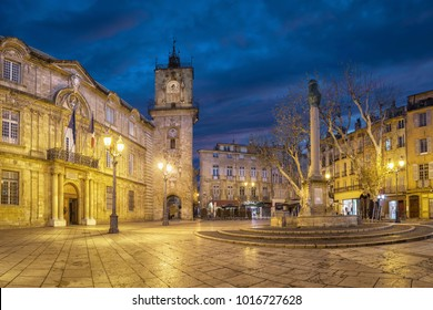 Town Hall square at dusk with City Hall building, clock tower and fountain in Aix-en-Provence, France