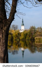 Town Hall tower in Litovel, Czech Republic, in the mirror of the pond