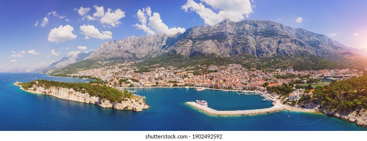 town with historic buildings in background, Baška Voda - Shutterstock ID 1902492592