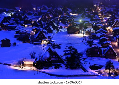 A town with a lot of houses in the snow.