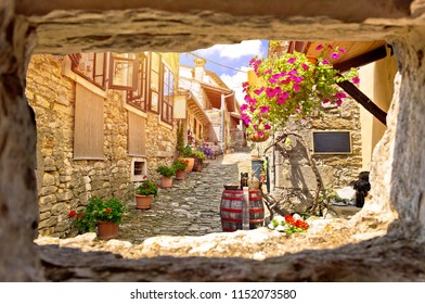 Town of Hum colorful old stone street view through stone window, Istria region of Croatia