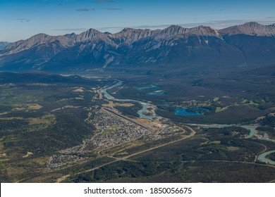 Town of Jasper Alberta, Canada from an aerial view and mountains and lakes in the distance