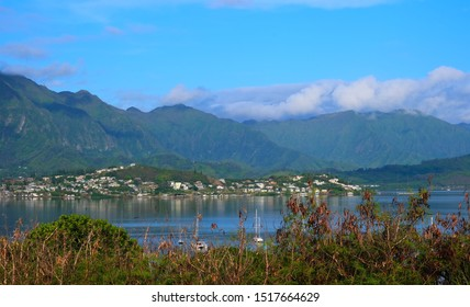 Town of Kaneohe, Oahu, Hawaii as seen from across the bay.  Kaneohe Bay in the foreground and Ko'olau Mountain range in the background.
