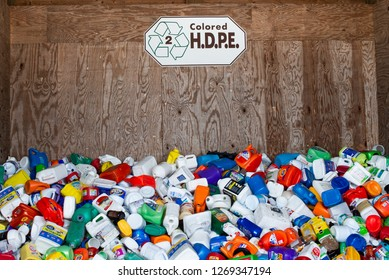 Town of Lake Pleasant, NY - August 7, 2018:  A bin full of colored dirty high-density polyethylene, HDPE, plastic containers at a recycling center.
