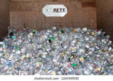 Town of Lake Pleasant, NY - August 7, 2018: A bin full of clear plastic containers, PETE, or Polyethylene terephthalateat, at a recycling center.